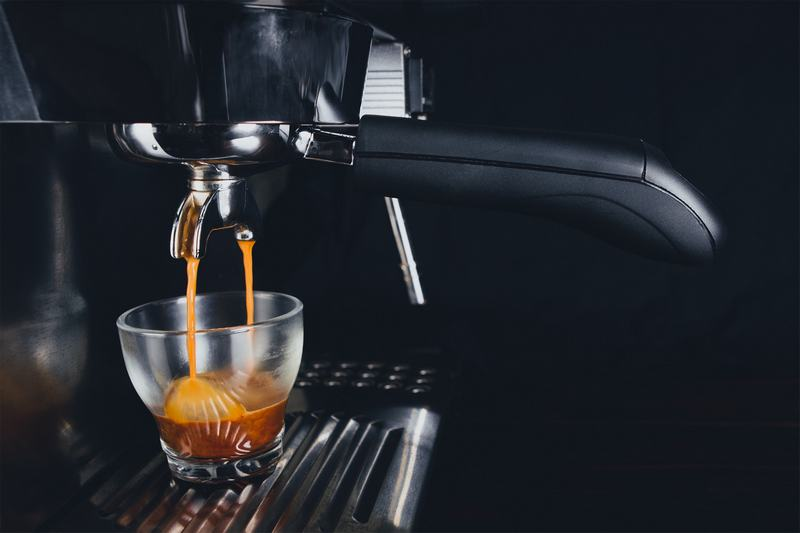 Espresso machine brewing hot cup